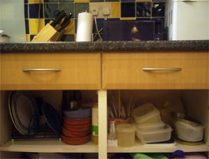 cluttered kitchen cupboard